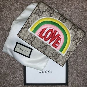 Gucci bifold monogram wallet